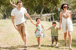 Family running with two young children